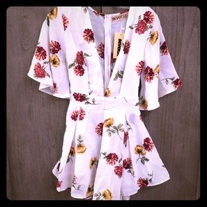 Reverse floral romper *with tags*